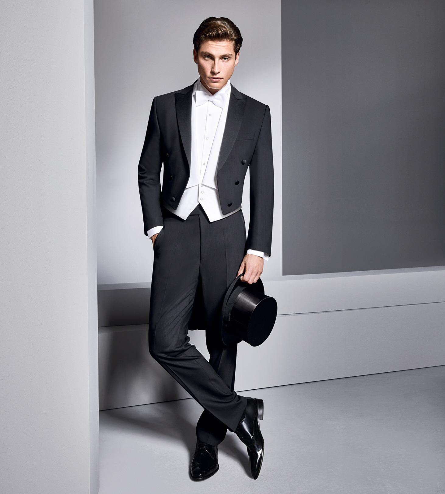 Wilvorst Hochzeitsanzug Männer Mode Anlass Bräutigam Frack klassische Form tailliert schwarz mit weisser Weste und Frackhemd weiß und weißer Fliege Zylinder schwarz